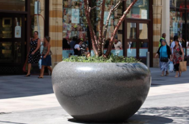 urban-furniture-planter-beside-sidewalk-of-shops