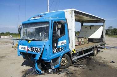 picture of truck after hitting a surface mounted safety barriers